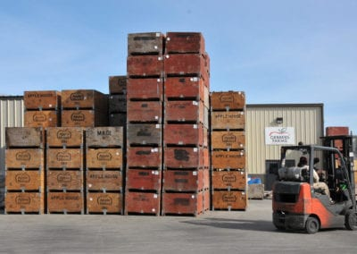 Apple bins ready to load into the warehouse for packing and shipping nationwide.