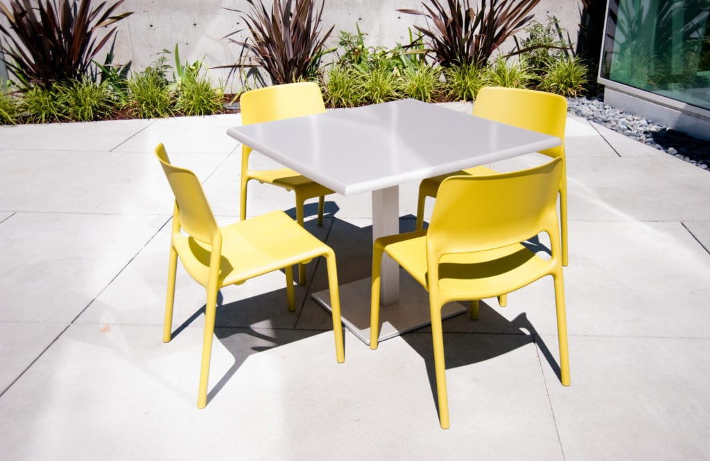 Yellow patio chairs and a table