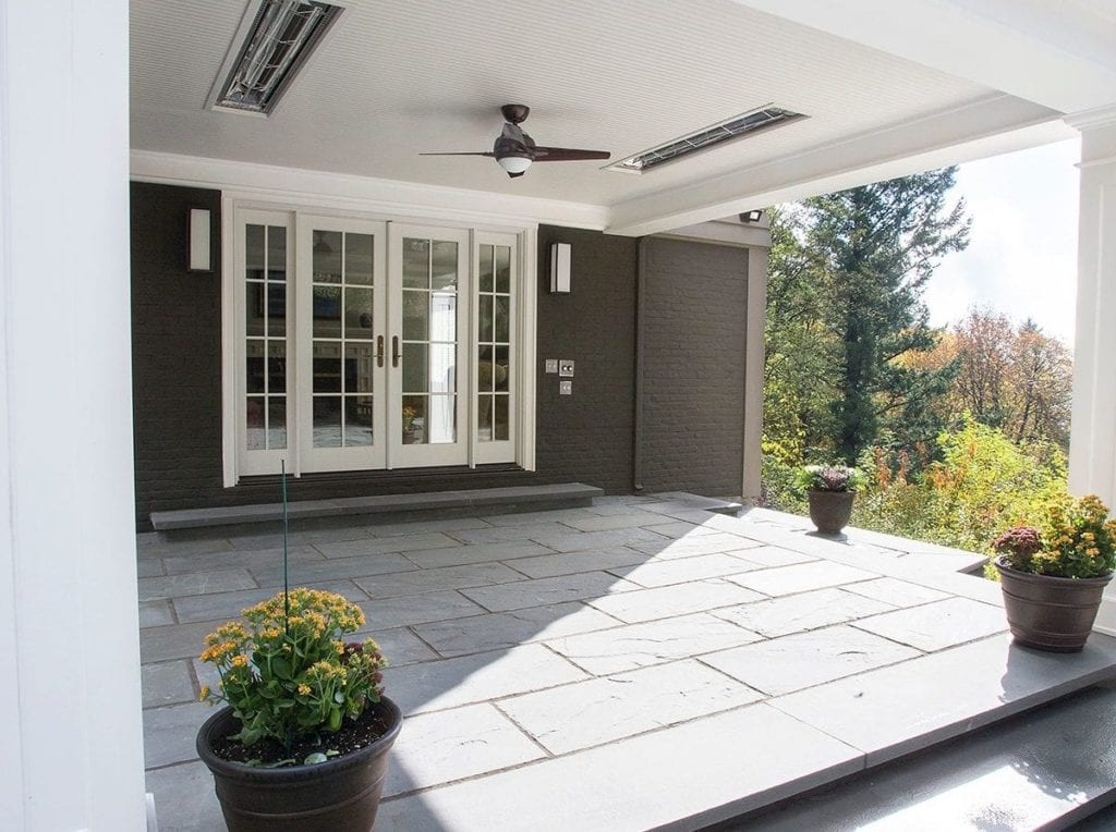 Exterior shot of a covered patio with built in heating lamps